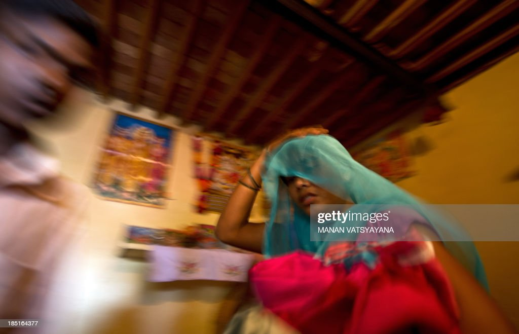 IndiacrimesocialtraffickingchildrenFEATURE by Trudy Harris In this photograph taken on September 16 an alleged Indian humantrafficking victim leaves...
