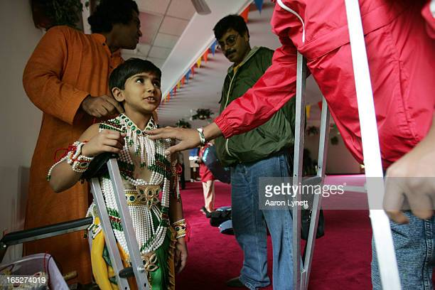 IndiaDance8yearold Kajal gets some help putting on her Krishna costume Kajal is part of a dance troupe composed of children from India with...