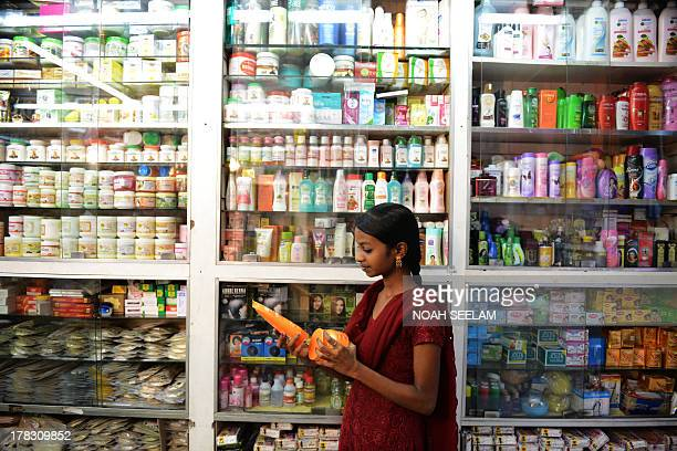 Indiaeconomyconsumersforexeducation by Penelope Macrae An Indian consumer checks imported hair products at a store in Hyderabad on August 26 2013...