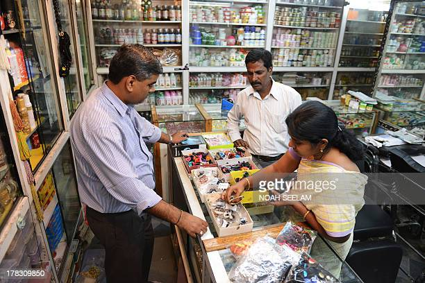 Indiaeconomyconsumersforexeducation by Penelope Macrae Indian consumers select hair clips at a store in Hyderabad on August 26 2013 With the currency...