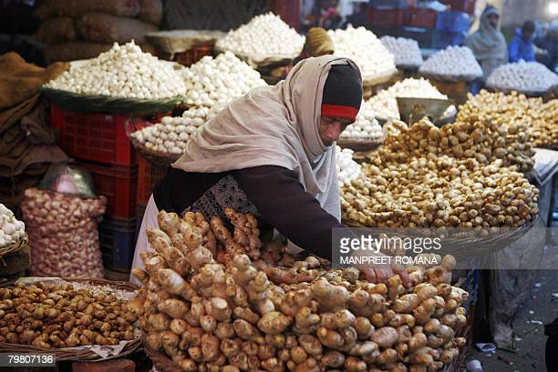 IndiaeconomyfoodFEATURE by Ed Lane An Indian shopkeeper arranges a display of ginger as he waits for customers in a wholesale vegetable and fruit...