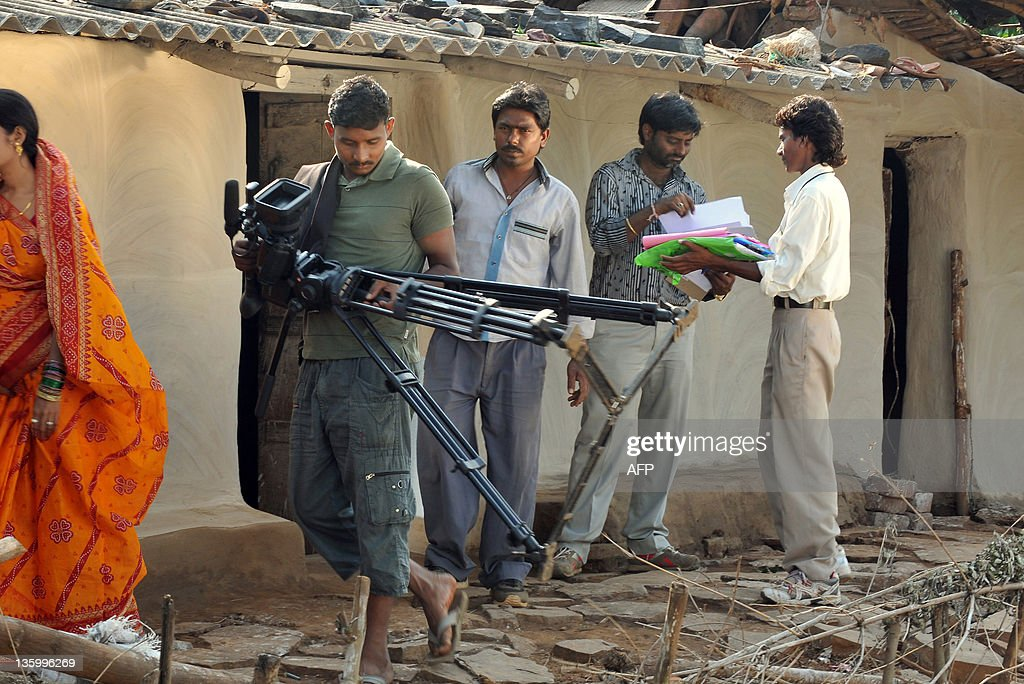 STORY 'Indiaentertainmentfilmsocietytribal' FEATURE In this picture taken on October 23 crew members of a film unit in action during the shooting of...