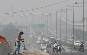 IndiaenvironmentpollutionhealthFOCUS by Annie Banerji An Indian sweeper cleans a flyover as smog covers the capital's skyline the morning after...