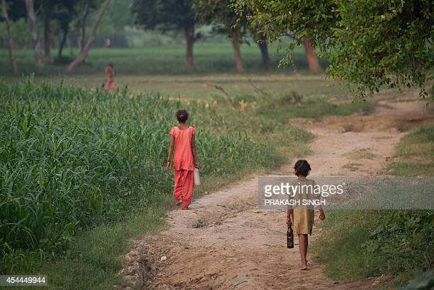 IndiahealthwomencrimesocialFOCUS In this photograph taken on August 31 Indian children walk to defecate in an open field in a village in the Badaun...