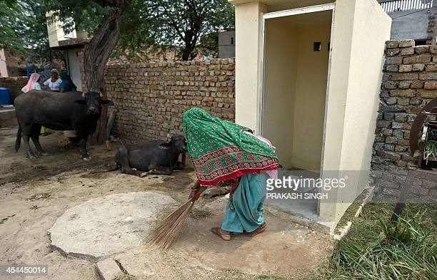 IndiahealthwomencrimesocialFOCUS In this photograph taken on August 29 Indian village resident Geeta sweeps around newlyconstructed toilets provided...