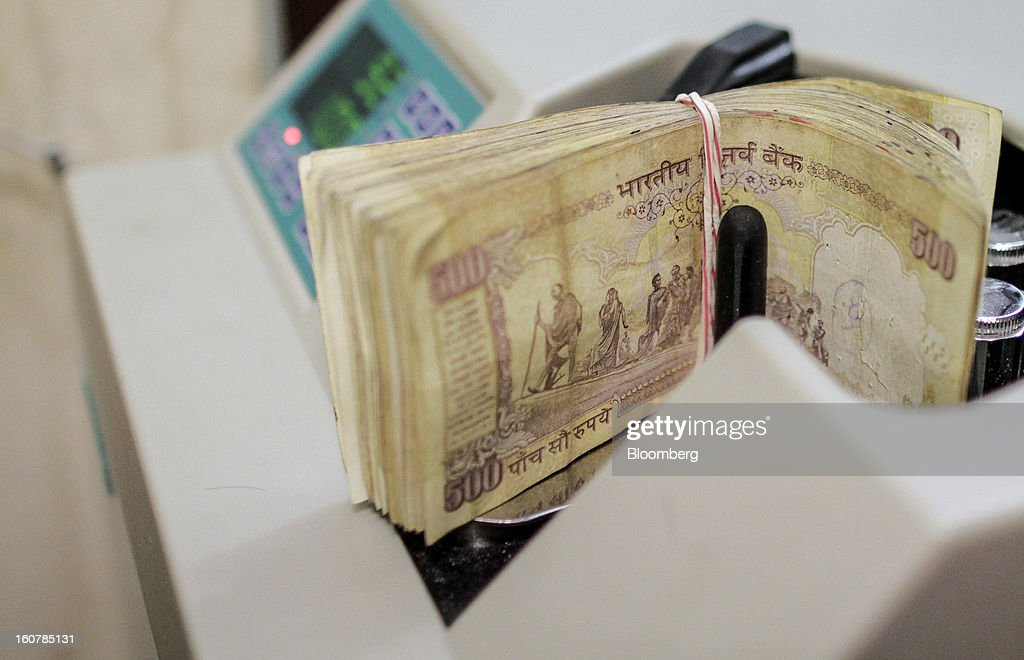 Indian 500 rupee banknotes are arranged for a photograph at a HDFC Bank Ltd. bank branch in Mumbai, India, on Friday, Feb. 1, 2013. HDFC Bank, India's second-largest lender by market value, is seeking to expand in the rural market of the world's second-most populated nation to bolster profits as competition in its cities intensifies. Photographer: Dhiraj Singh/Bloomberg via Getty Images