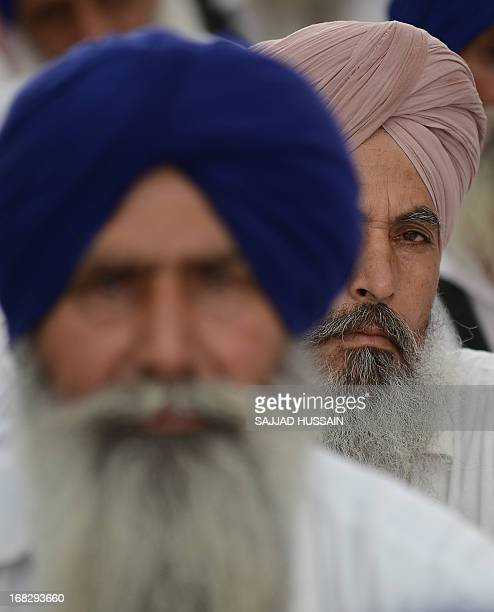 Indian activists and supporters of Shiromani Akali Dal look on during a protest against the acquittal of Congress politician Sajjan Kumar in New...