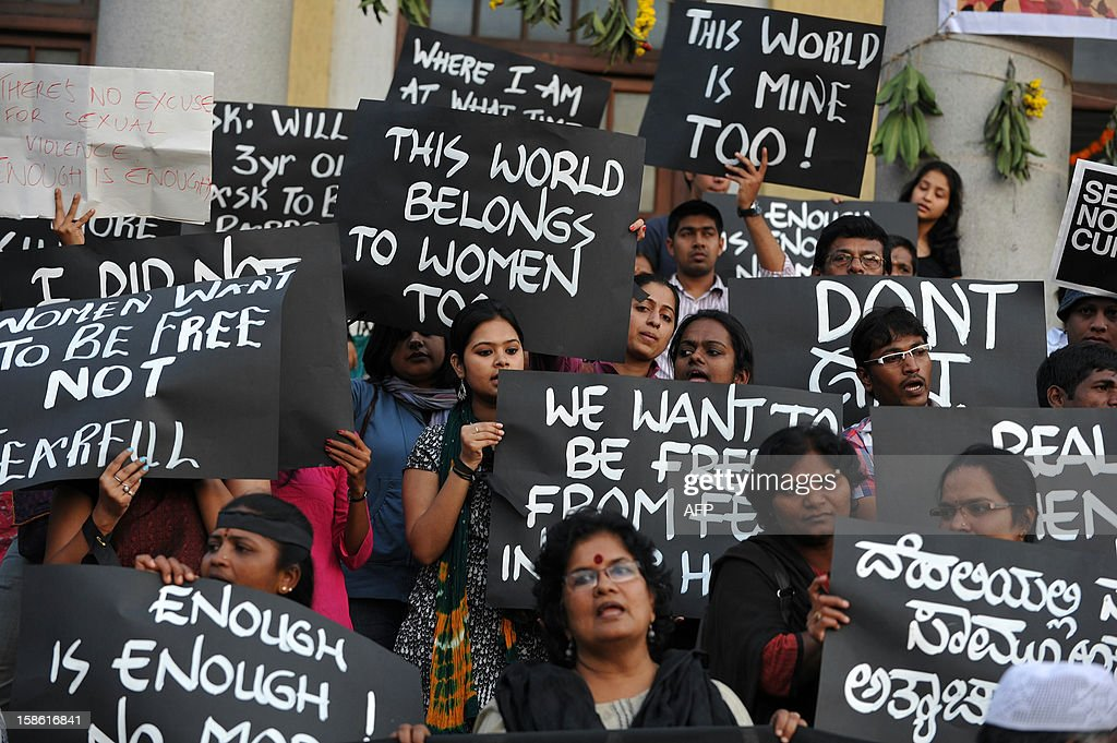 Indian activists belonging to various rights organisations hold placards while they stage a demonstration in Bangalore on December 21, 2012, condemning the recent gang rape in New Delhi. India's government, facing swelling protests over the gang-rape of a female student on a bus, has vowed to press for life sentences for her six attackers and promised stricter policing. AFP PHOTO/Manjunath KIRAN