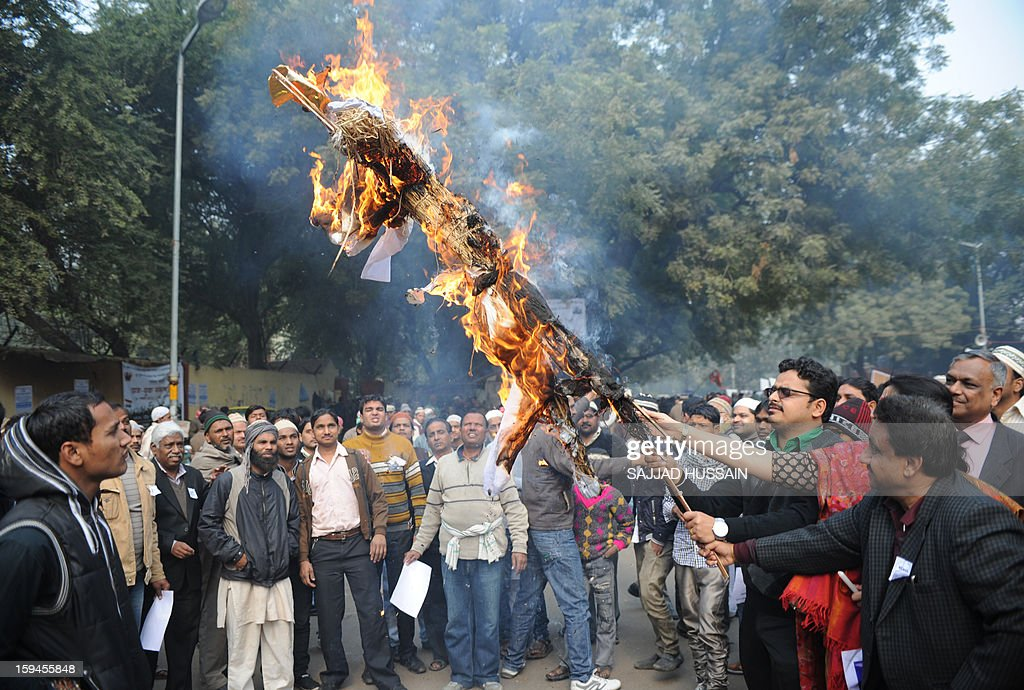 Indian activists burn an effigy representing social downfall during a protest against the gang rape and murder of a student in New Delhi on January 14, 2013. Five men appeared in court for the third time on January 14, to face charges over the murder and gang-rape of a 23-year-old student in New Delhi amid chaotic scenes that forced the hearing behind closed doors.