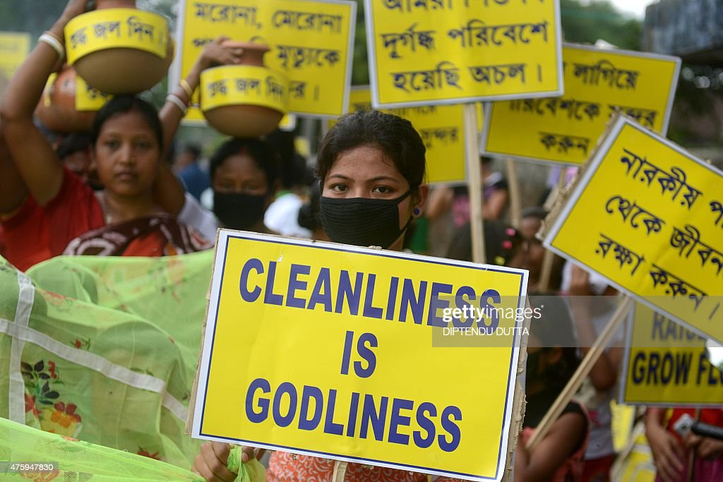 Indian activists carry placards during an environment awareness campaign in Siliguri on June 5 on the occasion of World Environment Day Social...