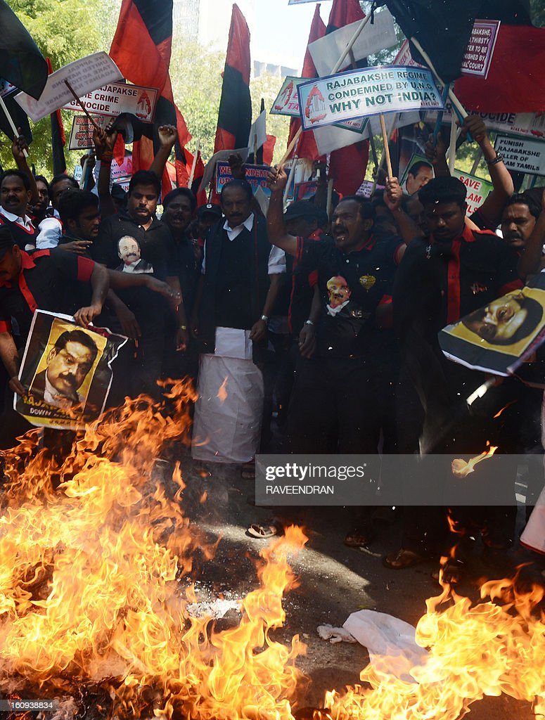 Indian activists from Marumalarchi Dravida Munnetra Kazhagam (MDMK) burn an effigy of Sri Lankan President Mahinda Rajapakse against his visit to India during a protest in New Delhi on February 8, 2013. Tamil groups are demanding that the Sri Lankan president return to his country. Sri Lankan forces crushed Tamil rebels in May 2009 after nearly three decades of brutal fighting with the conflict claiming up to 100,000 lives, according to UN estimates. AFP PHOTO/ RAVEENDRAN