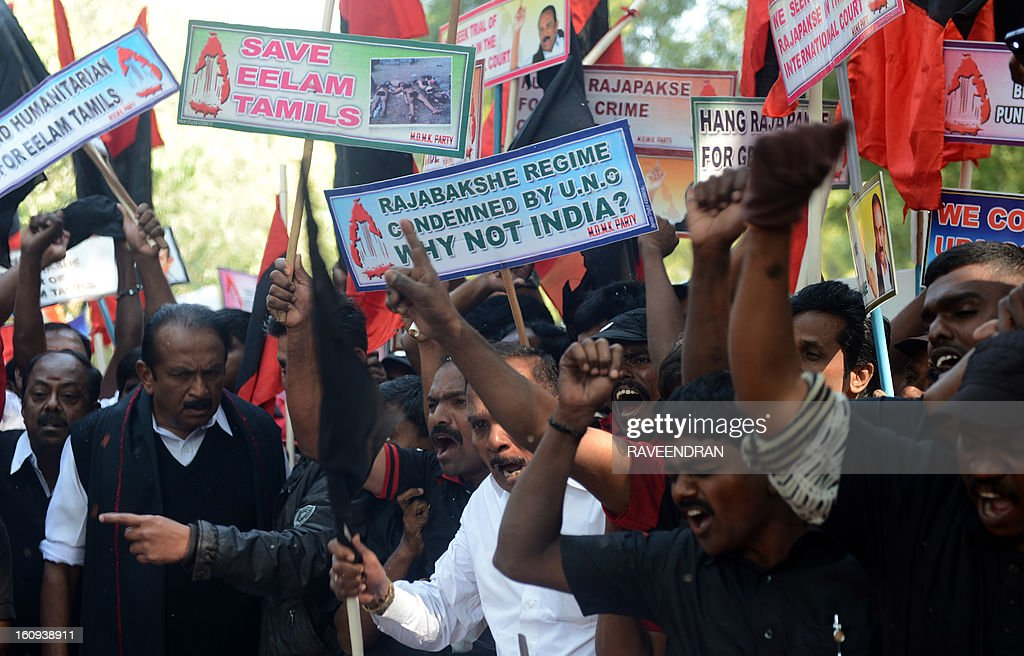 Indian activists from Marumalarchi Dravida Munnetra Kazhagam (MDMK) shout slogans against Sri Lankan President Mahinda Rajapakse against his visit to India during a protest in New Delhi on February 8, 2013. Tamil groups are demanding that the Sri Lankan president return to his country. Sri Lankan forces crushed Tamil rebels in May 2009 after nearly three decades of brutal fighting with the conflict claiming up to 100,000 lives, according to UN estimates. AFP PHOTO/ RAVEENDRAN