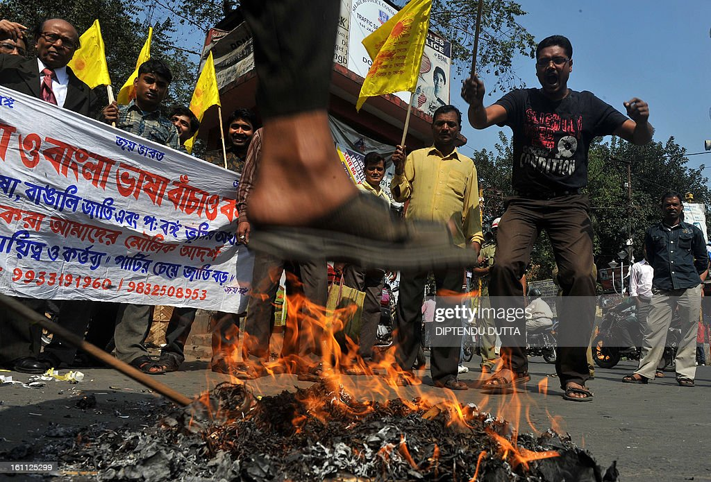 Indian activists from the Bangla O Bangla Bhasa Bachao Committee burn effigies of Gorkha Janmukti Morcha (GJMM) Supremo Bimal Gurung in Siliguri on February 9, 2013, during a 12-hour strike in Darjeeling, Kalimpong, Mirik and the nearby hills. The GJMM is demanding a separate state within India for the Gorkha people in northern West Bengal which affects the tea and tourism industries. AFP PHOTO/Diptendu DUTTA