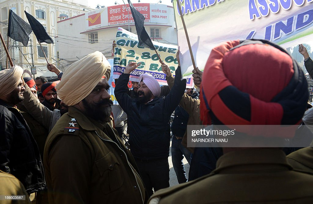Indian activists from the Canadian Backloggers Pre-2008 Associationshout slogans as they rally against Canada's Minister of Citizenship, Immigration and Multiculturalism, Jason Kenney during a protest against the delay in processing of their visa applications near the Sikh Shrine Golden temple in Amritsar on January 11,2013. Kenney visited the city to tour the Sikh Shrine and address a press conference where he advised applicants to be cautious of immigration fraud when coming to Canada.