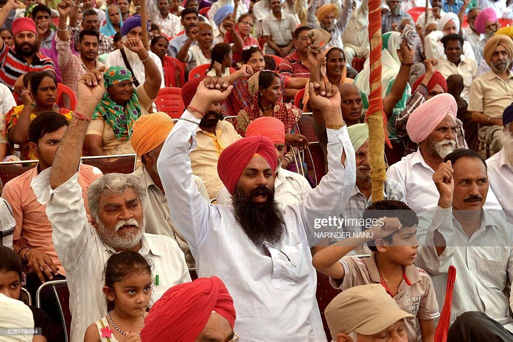 Indian activists from the Communist Party of India along with factory workers shout slogans during a protest rally against alleged antiworker...