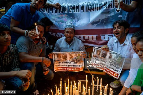 Indian activists from the Indian Youth Congress shout slogans during a protest over an attack on pilgrims taking part in the Amarnath Yatra in New...