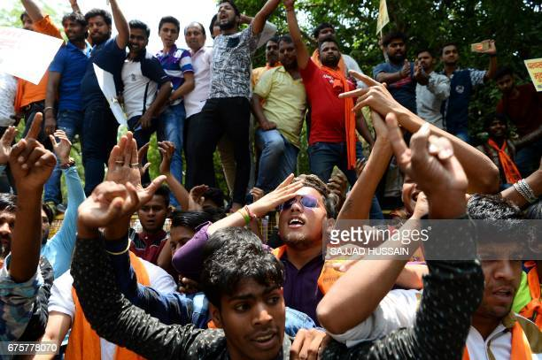 Indian activists from the rightwing Bajrang Dal organisation shout antiPakistani slogans during a protest in New Delhi on May 2 held to condemn both...