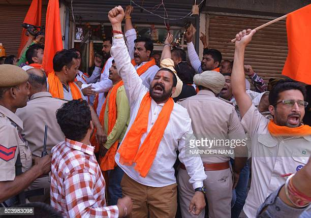 Indian activists from the Shiv Sena organisation shout slogans against the state government during a strike in Amritsar on April 25 2016 Activists...