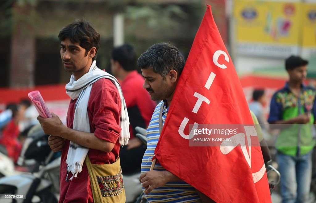 Indian activists from the The Centre of Indian Trade Unions (CITU)participate in a May Day rally in Allahabad on May 1, 2016. Workers from various labour groups took to the streets on the occasion of the International Labour Day which is observed worldwide. / AFP / SANJAY