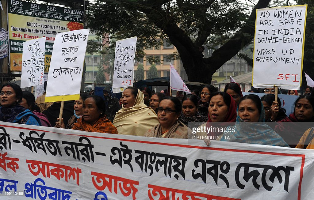 Indian activists from the women's wing of the Communist Party of India- Marxist (CPI-M) hold placards during a protest against the gang rape and murder of a student in the Indian captial, New Delhi, in Siliguri on January 8, 2013. Five men appeared in court for the first time on January 7, to face charges over the murder and gang-rape of a 23-year-old student in New Delhi amid chaotic scenes that forced the hearing behind closed doors. AFP PHOTO/Diptendu DUTTA