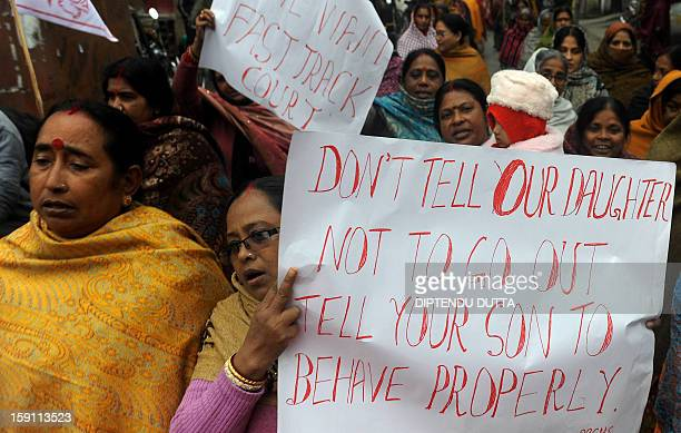 Indian activists from the women's wing of the Communist Party of India Marxist hold placards during a protest against the gang rape and murder of a...