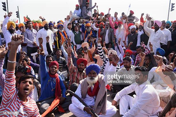 Indian activists from various Dalit organisations shout slogans against the state government during a demonstration as they block traffic at Bhandari...