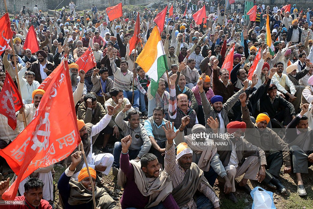 Indian activists from various trade unions block the tracks during a two-day strike opposing the current UPA government's economic policies at the railway station in Amritsar on February 20, 2013