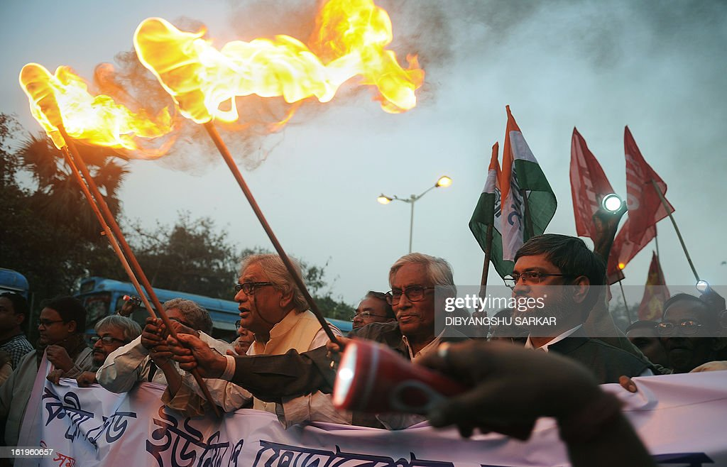 Indian activists from various trade unions participate in a torch-light rally in support of the upcoming two-day All India General Strike on 20 - 21 February in Kolkata, on February 18, 2013. For the first time in the history of India all the eleven Central Trade Unions and thousands of Independent Federations have given a call to the workers to observe the teo-day All India General Strike protesting against the policies of the Government. Millions of workers across the country in private sector, public sector, Central and State Govternment employee sector are expected to participate in this strike AFP PHOTO/Dibyangshu SARKAR