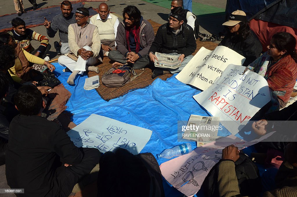 Indian activists hold placards as they participate in a protest against the gang rape and murder of a student in New Delhi on February 7, 2013. The companion of an Indian medical student who died after being gang-raped on a bus in New Delhi will be giving evidence in the trial of five adults accused of her murder. AFP PHOTO/ RAVEENDRAN
