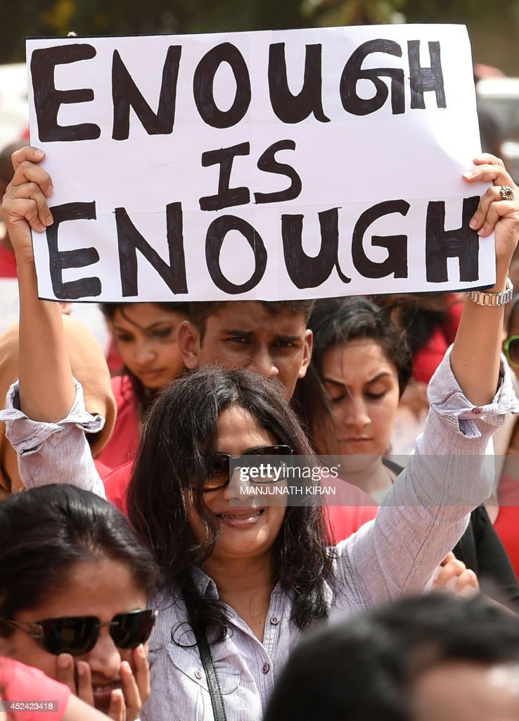 Indian activists hold placards during a rally organised by 'The Red Brigade Bring Bangalore Back' to protest against the recent incidents of sexual...