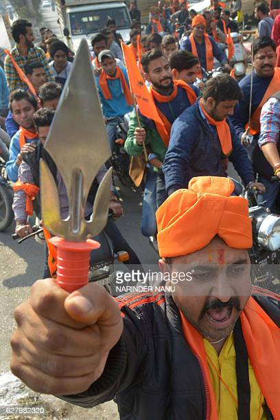 Indian activists of Hindu Bajrang Dal along with the Vishva Hindu Parishad raise religious slogans during a procession marking the 24th anniversary...