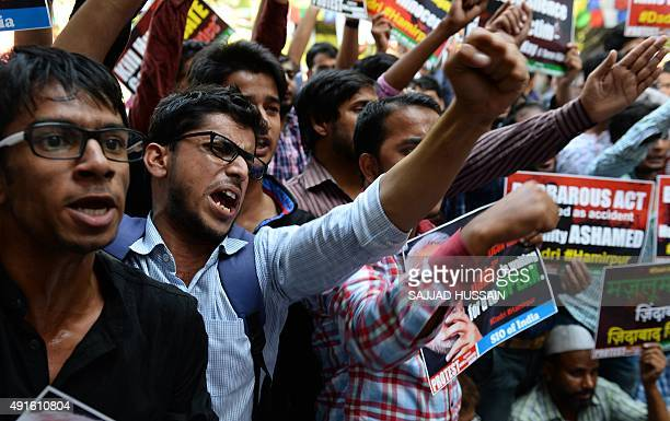 Indian activists of religious and political parties shout slogans against Indian Prime Minister Narendra Modi during a protest in New Delhi on...
