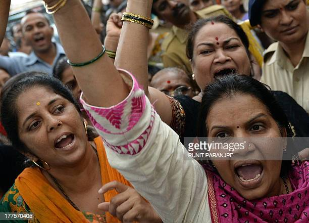 Indian activists of Shiv Sena Party shout slogans outside the court after a suspect in the gangrape of a female photographer was produced in Mumbai...