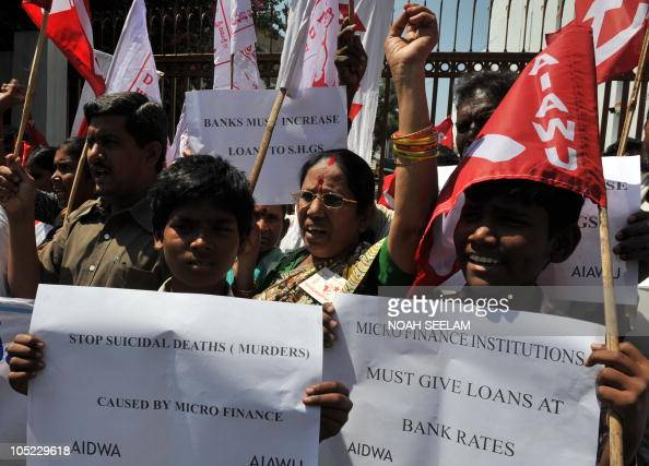 Indian activists of The AllIndia Democratic Women's Association and their supporters hold placards protest in front of the Reserve Bank of India...
