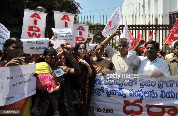 Indian activists of The AllIndia Democratic Women's Association protest in front of the Reserve Bank of India against Micro Finance Institutions in...