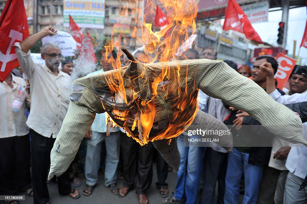 Indian activists of the Communist Party of India-Marxists (CPI-M) burn an effigy representing the United Progressive Alliance (UPA) government during their protest against the fuel price hike in Hyderabad on February 16, 2013. State-run fuel retailers raised petrol prices by 1.50 INR per litre and diesel by 45 paise per litre, excluding local tax, asof midnight February 15. AFP PHOTO / Noah SEELAM