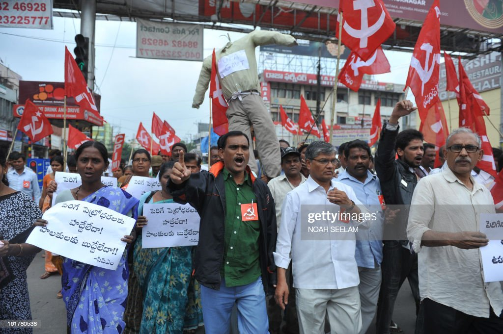 Indian activists of the Communist Party of India-Marxists (CPI-M) carry an effigy representing the United Progressive Alliance (UPA) government during their protest against the fuel price hike in Hyderabad on February 16, 2013. State-run fuel retailers raised petrol prices by 1.50 INR per litre and diesel by 45 paise per litre, excluding local tax, asof midnight February 15. AFP PHOTO / Noah SEELAM