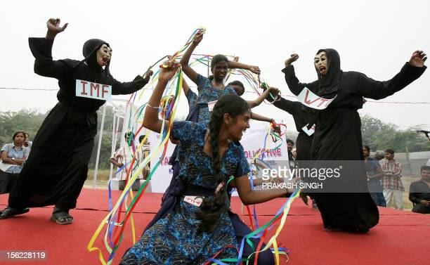 Indian activists of the Women Collective Forum from the southern state of Tamil Nadu present a play against the World Trade Organistion World Bank...