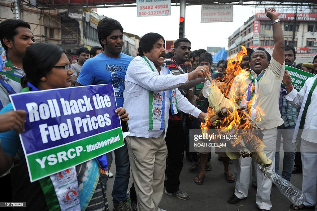 Indian activists of Y S Rajasekhar Reddy Congress Party (YSRCP) burn an effigy representing the United Progressive Alliance (UPA) government during their protest against the fuel price hike in Hyderabad on February 16, 2013. State-run fuel retailers raised petrol prices by 1.50 INR per litre and diesel by 45 paise per litre, excluding local tax, asof midnight February 15. AFP PHOTO / Noah SEELAM