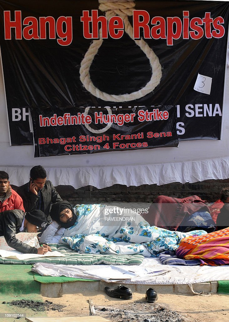 Indian activists on hunger strike lay on the ground during a protest in New Delhi on January 8, 2013, against the gang rape and murder of a student. Five men appeared in court for the first time on January 7,to face charges over the murder and gang-rape of a 23-year-old student in New Delhi amid chaotic scenes that forced the hearing behind closed doors.