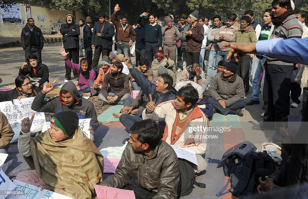 Indian activists shout anti-government slogans during a protest in New Delhi on January 8, 2013, against the gang rape and murder of a student. Five men appeared in court for the first time on January 7,to face charges over the murder and gang-rape of a 23-year-old student in New Delhi amid chaotic scenes that forced the hearing behind closed doors.