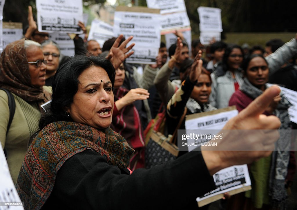 Indian activists shout slogans during a protest for the implementation of harsher punishments and quicker trials for rape cases in New Delhi on February 4,2013. A government-appointed panel recommended harsher punishments for rapists, including the death penalty,after the death of the women, who spent nearly two weeks fighting for her life before succumbing to her injuries in a Singapore hospital where she was flown for last-ditch treatment. AFP PHOTO/ SAJJAD HUSSAIN