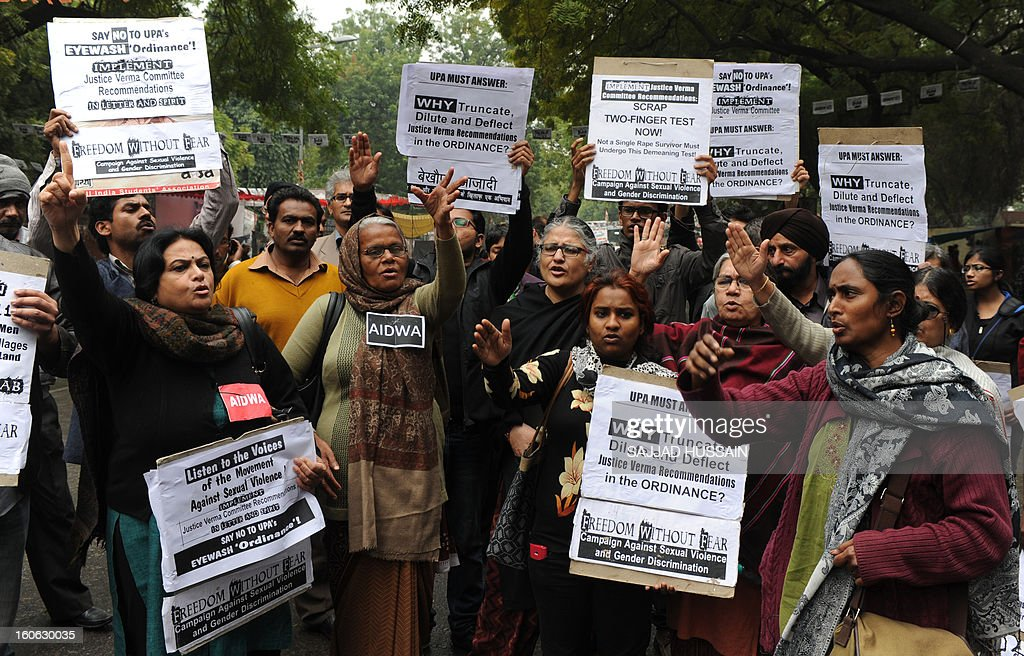 Indian activists shout slogans during a protest for the implementation of harsher punishments and quicker trials for rape cases in New Delhi on February 4,2013. A government-appointed panel recommended harsher punishments for rapists, including the death penalty,after the death of the women, who spent nearly two weeks fighting for her life before succumbing to her injuries in a Singapore hospital where she was flown for last-ditch treatment.