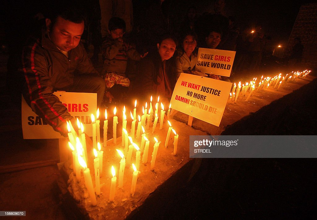 Indian activists take part in a candlelight vigil in Agartala on December 30, 2012, after the cremation ceremony for a gangrape victim. The victim of a gang-rape and murder which triggered an outpouring of grief and anger across India was cremated at a private ceremony, hours after her body was flown home from Singapore. A student of 23-year-old, the focus of nationwide protests since she was brutally attacked on a bus in New Delhi two weeks ago, was cremated away from the public glare at the request of her traumatised parents. AFP PHOTO/STR