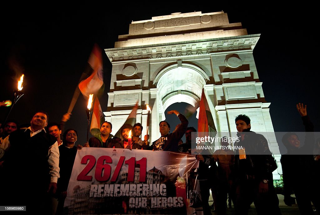 Indian activists take part in a candle-light vigil in memory of people who lost their lives in the 2008 Mumbai terror attacks, in New Delhi on November 26, 2012. A total of 166 people were killed and more than 300 others were injured when 10 heavily-armed Islamist militants stormed the city on November 26, 2008, attacking a number of sites, including the city's main railway station, two luxury hotels, a popular tourist restaurant and a Jewish centre.