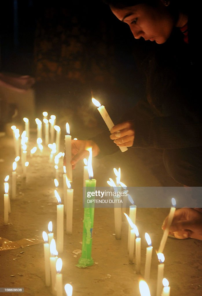 Indian activists take part in a candlelight vigil in Siliguri on December 30, 2012, after the cremation ceremony for a gangrape victim. The victim of a gang-rape and murder which triggered an outpouring of grief and anger across India was cremated at a private ceremony, hours after her body was flown home from Singapore. A student of 23-year-old, the focus of nationwide protests since she was brutally attacked on a bus in New Delhi two weeks ago, was cremated away from the public glare at the request of her traumatised parents. AFP PHOTO/Diptendu DUTTA