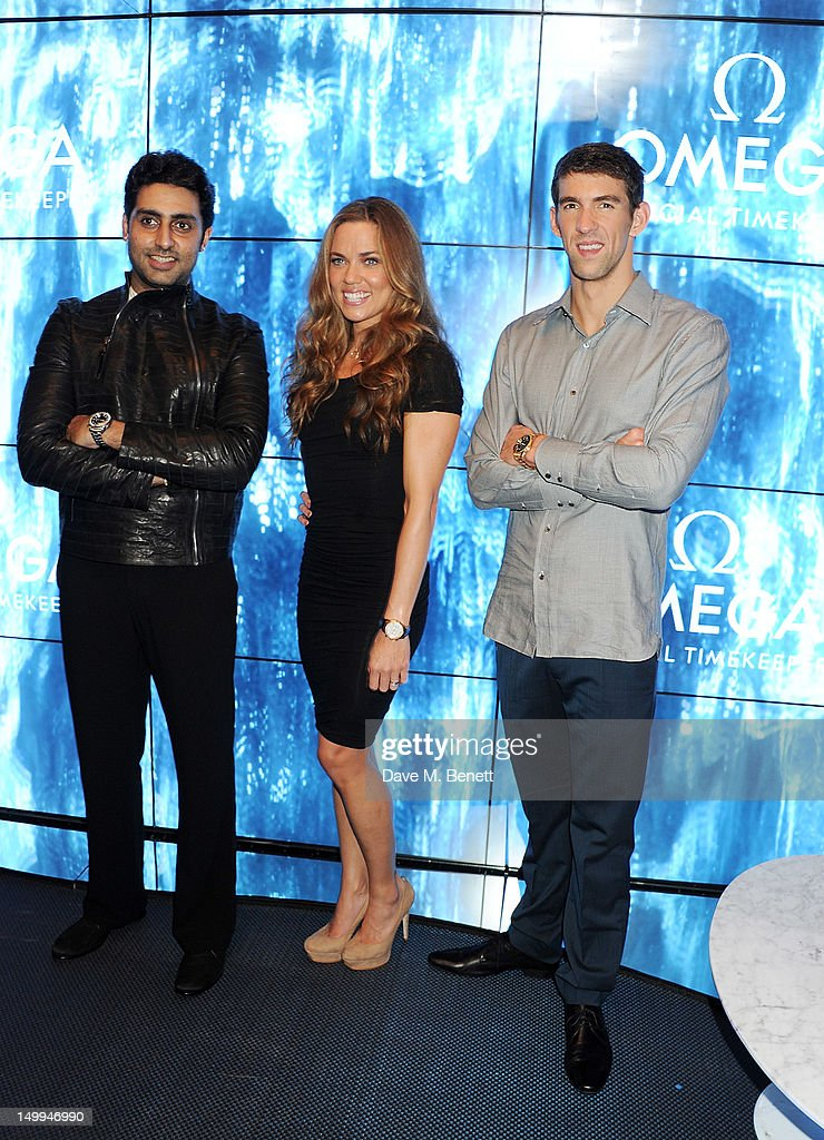 Indian actor <a gi-track='captionPersonalityLinkClicked' href=/galleries/search?phrase=Abhishek+Bachchan&family=editorial&specificpeople=549431 ng-click='$event.stopPropagation()'>Abhishek Bachchan</a> and U.S. Olympic Swimmers <a gi-track='captionPersonalityLinkClicked' href=/galleries/search?phrase=Natalie+Coughlin+-+Swimmer&family=editorial&specificpeople=171726 ng-click='$event.stopPropagation()'>Natalie Coughlin</a> and <a gi-track='captionPersonalityLinkClicked' href=/galleries/search?phrase=Michael+Phelps&family=editorial&specificpeople=162698 ng-click='$event.stopPropagation()'>Michael Phelps</a> attend 'Spotlight On Swimming' at OMEGA House, OMEGA's official residence during the London 2012 Olympic Games, at The House of St. Barnabas on August 7, 2012 in London, England.