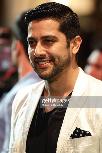 Indian actor Aftab Shivdasani poses on the green carpet during the IIFA Rocks Green Carpet on day two of the 2012 International India Film Academy...