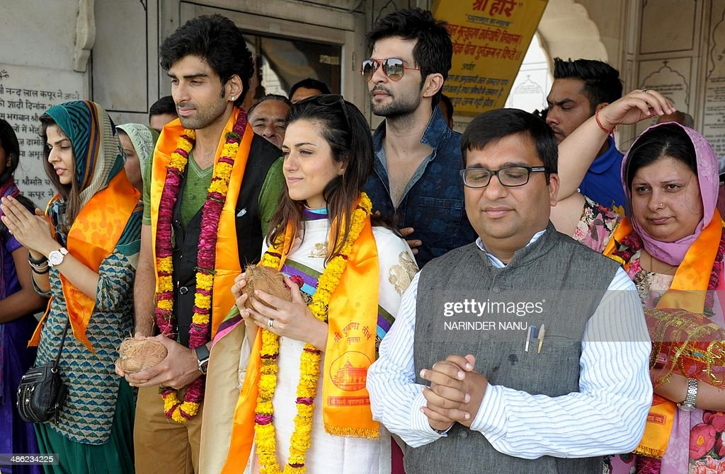 Indian actor Akshay Dogra (2L), television actress Ridhi Dogra Vashisth (3L), actor Raqesh Vashisth (C), BJP Yuva Morcha Punjab President Mohit Gupta (2R) and daughter of Bharatiya Janata Party (BJP) senior leader and candidate for Amritsar's parliamentary seat Arun Jaitley, Sonali Jaitley (R), pose for a photograph during a campaign event for Arun Jaitley at a temple in Amritsar on April 23, 2014. India's 814-million-strong electorate is voting in the world's biggest election which is set to sweep the Hindu nationalist opposition to power at a time of low growth, anger about corruption and warnings about religious unrest.