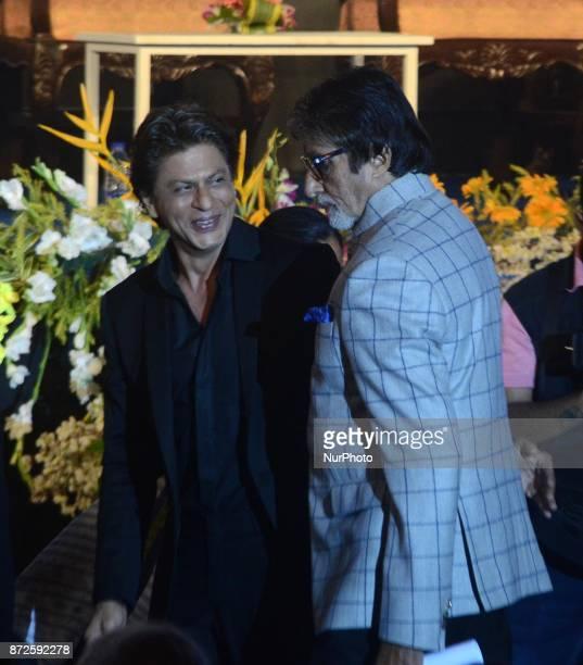 Indian Actor Amitabh Bachchan and Shah Rukh Khan greets during the inauguration ceremony of 23rd Kolkata International Film Festival in Kolkata India...